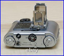 Concava Tessina Microcamera svizzera reflex 35mm TLR motorizzata a molla