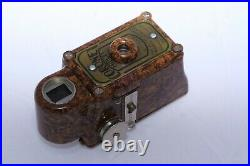 Coronet Midget 16mm compact bakelite collectible camera. Brown color with case