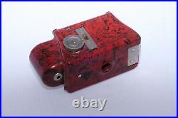 Coronet Midget 16mm compact bakelite collectible camera. Red color. Circa 1935