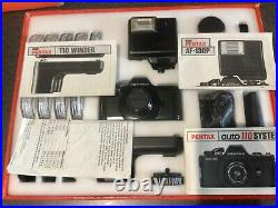 Pentax Auto 110 SLR complete large outfit in original Box. Nice condition