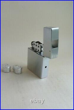 Suzuki Cameralite lighter subminiature camera, with two unused film rolls, exc